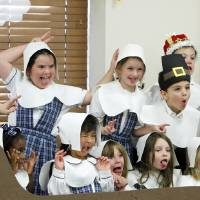Photo - First-graders dressed as pilgrims pose for a silly-face photo after the Thanksgiving pageant at St. Mary's Episcopal School.