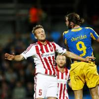 Photo - Aalborg BK's Kenneth Emil Petersen, left, and Apoel FC's Cillian Sheridan of Ireland, right, vie for the ball during their Champions League play-off first leg soccer match at Aalborg Stadium, Denmark, Wedensday, Aug. 20, 2014. (AP Photo/Polfoto, Gregers Tycho) DENMARK OUT
