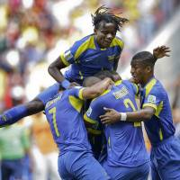 Photo - Ecaudor players celebrate after Enner Valencia scored the opening goal during the group E World Cup soccer match between Switzerland and Ecuador at the Estadio Nacional in Brasilia, Brazil, Sunday, June 15, 2014. (AP Photo/Michael Sohn)
