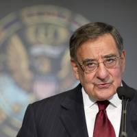 Photo - Secretary of Defense Leon Panetta delivers his speech to Georgetown University students and faculty on leadership and public service in Washington, Wednesday, Feb. 6, 2013.   (AP Photo/Manuel Balce Ceneta)