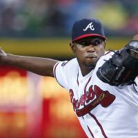 Photo - Atlanta Braves starting pitcher Julio Teheran delivers in the first inning of a baseball game against the Chicago Cubs, Friday, May 9, 2014, in Atlanta. (AP Photo/John Bazemore)