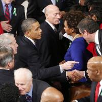 Photo - President Barack Obama is greeted after giving his State of the Union address during a joint session of Congress on Capitol Hill in Washington, Tuesday Feb. 12, 2013. (AP Photo/J. Scott Applewhite)