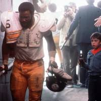 Photo - Mean Joe Greene is shown here in a moment from his memorable 1979 Coca-Cola commercial.