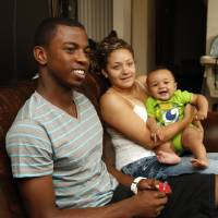Photo - HIGH SCHOOL FOOTBALL PLAYER: Jalen Adams, Moore football player, talks about home and family on Wednesday, June 19, 2013, in Moore, Okla.  Beside him is his girlfriend Kortni Whitfield and their son Jeremiah.   Photo by Steve Sisney, The Oklahoman
