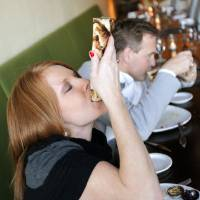 Photo - Erica Millar and her husband, Kyle Millar, try a Bone Marrow Luge at Ludivine in Oklahoma City, Thursday, Feb. 16, 2012. Photo by Nate Billings, The Oklahoman