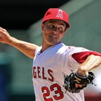 Photo -   Los Angeles Angels starter Zack Greinke pitches to the Tampa Bay Rays in the second inning of a baseball game in Anaheim, Calif., Sunday, July 29, 2012. Greinke made his debut with the Angels after being traded by the Milwaukee Brewers. (AP Photo/Reed Saxon)