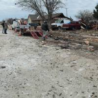 Photo -  A house explosion left debris in a neighborhood of northwest Oklahoma City early Saturday near NW 122 and N Council Road. Three people were taken to a hospital. [PHOTO BY PAUL HELLSTERN, THE OKLAHOMAN]