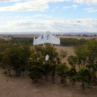 Photo - This undated image provided by Google shows a Project Wing drone vehicle during delivery. Google's secretive research laboratory is trying to build a fleet of drones designed to bypass earthbound traffic so packages can be delivered to people more quickly. The ambitious program announced Thursday, Aug. 28, 2014, escalates Google's technological arms race with rival Amazon.com Inc., which also is experimenting with self-flying vehicles to carry merchandise bought by customers of its online store. (AP Photo/Google)