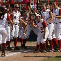 Photo - Alabama celebrates for Kaila Hunt (10) after a home run during a Women's College World Series game between Alabama and California at ASA Hall of Fame Stadium in Oklahoma City, Sunday, June 3, 2012.  Photo by Garett Fisbeck, The Oklahoman