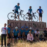 Photo - Members of the national Bike 4 Friendship Cross-Country Tour pose for a photo after crossing into Oklahoma.Photo provided  Carla Hinton - The Oklahoman