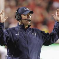 Photo -   Penn State head coach Bill O'Brien makes the touchdown gesture as officials rule that Penn State's Matt Lehman fumbled the ball before entering Nebraska's end zone in the second half of an NCAA college football game in Lincoln, Neb., Saturday, Nov. 10, 2012. Nebraska won 32-23. (AP Photo/Nati Harnik)