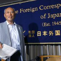 Photo - Tokyo Gov. Yoichi Masuzoe arrives at the Foreign Correspondents' Club of Japan for a press conference in Tokyo Wednesday, July 30, 2014. Masuzoe has defended his call for a review of the venue plan for the Tokyo 2020 Olympics, even if it threatens the proposal of having almost all the facilities close to the Athlete's Village. Tokyo won the right to host the 2020 Olympics with a promise to deliver a compact games with 28 of the proposed 33 competition venues within 5 miles (8 kilometers) of the village. (AP Photo/Shizuo Kambayashi)