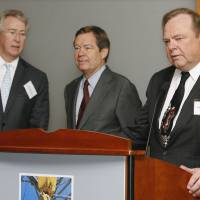 Photo - Harold Hamm, right, CEO of Continental Resources Inc., speaks at a luncheon for legislators about energy in Oklahoma City in 2008. At left are Aubrey McClendon, former CEO of Chesapeake Energy Corp., and Larry Nichols, executive chairman of Devon Energy Corp.  PAUL B. SOUTHERLAND - PAUL B. SOUTHERLAND
