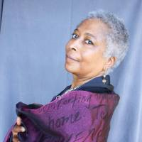 Photo - Alice Walker poses with a scrim of her writings for a photo by M.J. Alexander.  PHOTO BY M.J. ALEXANDER    ORG XMIT: 0911161605573061
