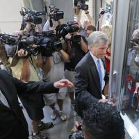 Photo - Former Virginia Gov. Bob McDonnell, right, arrives at federal court with his attorney, Henry Asbill, left, Wednesday, Aug. 20, 2014, in Richmond, Va.  The defense continues to present its case in McDonnell's corruption case.  (AP Photo/Steve Helber)
