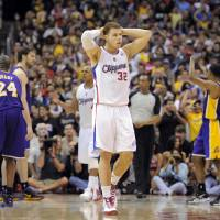 Photo - Los Angeles Clippers forward Blake Griffin (32) reacts after committing a foul late in their NBA basketball game against the Los Angeles Lakers, Wednesday, April 4, 2012, in Los Angeles. The Lakers won 113-108. (AP Photo/Mark J. Terrill)  ORG XMIT: LAS111