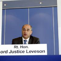 Photo -   FILE - In this July 28, 2011 file photo, Lord Justice Brian Leveson speaks during the first formal session of his phone hacking inquiry in London. Leveson, who spent a year investigating the misdeeds of Britain's lively newspapers, is giving Britain's Prime Minister David Cameron an early look at his recommendations on Wednesday, Nov. 28, 2012 for the regulation of the press. (AP Photo/Sean Dempsey, Pool-File)