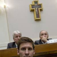 Photo - Argentine forward Lionel Messi attends a news conference at the Vatican, Tuesday, Aug.13, 2013. Two big-name Argentines have had a VIP meeting at the Vatican, Pope Francis and Barcelona football star Lionel Messi. The player, his fellow teammates on the Argentine national soccer squad as well as Italy's national team players were enjoying a private audience Tuesday with the first Latin American-born pontiff in the Apostolic Palace. The teams meet Wednesday in Rome in a friendly match. Francis told the players to remember they are role models on and off the field