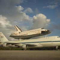 Photo -   This photo provided by NASA shows space shuttle Endeavour atop NASA's Shuttle Carrier Aircraft, or SCA, at the Shuttle Landing Facility at NASA's Kennedy Space Center on Monday, Sept. 17, 2012 in Cape Canaveral, Fla. The beginning of Endeavour's final flight to California has been postponed because of weather along the flight route. NASA had planned for the 747 carrying the shuttle to take off from Kennedy Space Center on Monday. (AP Photo/NASA, Bill Ingalls)