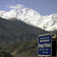 Photo - CORRECTS THE NUMBER OF THE KILLED FOREIGN TOURISTS - FILE - In this May 4, 2004 file photo, Nanga Parbat, the ninth highest mountain in the world, is seen from Karakorum Highway leading to neighboring China in Pakistan's northern area. Gunmen wearing police uniforms killed nine foreign tourists and one Pakistani before dawn Sunday, June 23, 2013 as they were visiting one of the world's highest mountains in a remote area of northern Pakistan, officials said. (AP Photo/Musaf Zaman Kazmi, File)