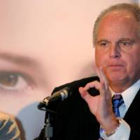 Photo -   FILE - In this Wednesday, Jan. 27, 2010 photo provided by the Las Vegas News Bureau, radio talk-show host Rush Limbaugh, one of six judges for the pageant, speaks during a Miss America news conference at Planet Hollywood in Las Vegas. Limbaugh drew fire Friday, March 2, 2012 from many directions for his depiction of a college student as a