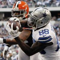 Photo -   Dallas Cowboys wide receiver Dez Bryant (88) grabs a touchdown catch in front of Cleveland Browns' Sheldon Brown, rear, in the second half of an NFL football game, Sunday, Nov. 18, 2012, in Arlington, Texas. (AP Photo/Brandon Wade)
