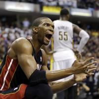 Photo - Miami Heat's Chris Bosh reacts after getting called for a foul against Indiana Pacers' Lance Stephenson during the second half of Game 3 of the NBA Eastern Conference basketball finals in Indianapolis, Sunday, May 26, 2013. (AP Photo/Nam H. Huh)