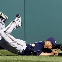 Photo -   Milwaukee Brewers center fielder Carlos Gomez misses a ball hit by Washington Nationals' Jayson Werth, who had a two RBI double on the play, during the fourth inning of a baseball game, Monday, Sept. 24, 2012, in Washington. The Nationals won 12-2. (AP Photo/Alex Brandon)