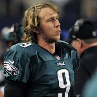 Photo - Philadelphia Eagles quarterback Nick Foles (9) watches action against the Dallas Cowboys during the second half of an NFL football game Sunday, Dec. 2, 2012 in Arlington, Texas. Dallas won 38-33. (AP Photo/LM Otero)