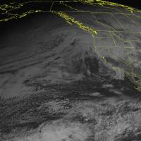 Photo - This NOAA satellite image taken Sunday, Dec. 16, 2012, at 02:00 PM EST, shows a frontal system moving into the Pacific Northwest and northern California bringing rain and heavy mountain snow. Snow will continue to fall over the Great Basin as the system moves eastward. A cold front moving south over the Northern Plains will bring snow showers. (AP Photo/Weather Underground)