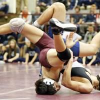Photo - Edmond Memorial's Dylan Vana, front, and Edmond North's Bryan Creel wrestle at 152 pounds during the Three Dog Night wrestling event at Edmond Memorial High School in Edmond, Okla., Monday, Jan. 14, 2013. Photo by Nate Billings, The Oklahoman