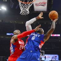 Photo - East Team's LeBron James of the Miami Heat is guarded by West Team's Kobe Bryant of the Los Angeles Lakers during the second half of the NBA All-Star basketball game Sunday, Feb. 17, 2013, in Houston. (AP Photo/Bob Donnan)