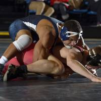 Photo - UCO's Cory Dauphin, top, will enter the MIAA Tournament with a 26-0 record and 44-match winning streak. Photo provided