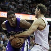 Photo - Sacramento Kings' Jason Thompson, left, is fouled by Cleveland Cavaliers' Luke Walton during the second quarter of an NBA basketball game on Wednesday, Jan. 2, 2013, in Cleveland. (AP Photo/Tony Dejak)