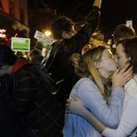 Photo -   Revelers kiss as they celebrate early election returns favoring Washington state Referendum 74, which would legalize gay marriage, during a large impromptu street gathering in Seattle's Capitol Hill neighborhood, in the early hours of Wednesday, Nov. 7, 2012. The re-election of President Barack Obama and Referendum 74 drew the most supporters to the streets. (AP Photo/Ted S. Warren)