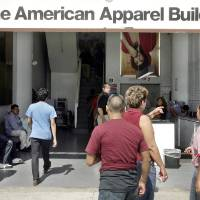Photo -  In this Sept. 9, 2008, file photo, employees head to work at American Apparel in Los Angeles. American Apparel Inc. said has reached a preliminary deal with investment firm Standard General to receive $25 million in financing to bolster the clothing chain's finances, a person close to the negotiations said Wednesday. AP PHOTO   Ric Francis
