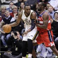 Photo - Washington Wizards' Emeka Okafor, right, defends against Utah Jazz's Al Jefferson (25) during the first quarter of their NBA basketball game, Wednesday, Jan. 23, 2013, in Salt Lake City. (AP Photo/Rick Bowmer)
