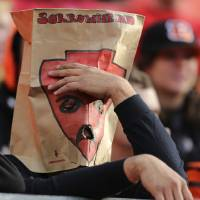 Photo -   A Kansas City Chiefs fan wears a paper bag with