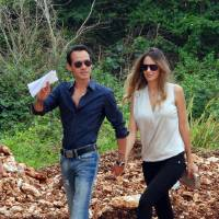 Photo -   In this image released by the Maestro Cares Foundation, singer Marc Anthony and his girlfriend, model Sharon de Lima, arrive for the groundbreaking ceremony of the new facilities for the Children of Christ orphanage in the eastern city of La Romana, Dominican Republic, Friday, Nov. 23, 2012. The foundation, run by Anthony with music and sports producer Henry Cardenas, plans to build a new residence hall, classrooms and a baseball field for the orphanage founded in 1996 for children who were abused or abandoned or whose parents were unable to care for them. (AP Photo/Maestro Cares Foundation)