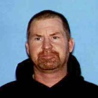 Photo - This undated photo released by the Shasta County Sheriff's office shows Shane Miller, 45, who is suspected of a triple homicide at his home in rural Northern California. Shasta County Sheriff's Lt. Tom Campbell said Miller remained on the loose on Wednesday, May, 8, 2013, a day after the killings six miles west of Shingletown. (AP Photo/Shasta County Sheriff)