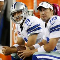 Photo - FILE - In this Monday Oct. 1, 2012 file photo, Dallas Cowboys' Tony Romo (9) and Kyle Orton (18) sit on the bench during an NFL football game against the Chicago Bears in Arlington, Texas. The Dallas Cowboys are releasing Kyle Orton after their backup quarterback missed all the offseason workouts amid reports that he was considering retirement, Tuesday, July 15, 2014. (AP Photo/Sharon Ellman, File)