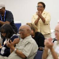 Photo - Melva Rich claps during a forum on State Question 759 at the OKC campus of Langston University, Thursday, Sept. 20, 2012.  Photo by Sarah Phipps, The Oklahoman