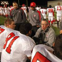 Photo - Carl Albert Titans head coach Gary Rose talks with players as his team plays the Del City Eagles in Class 5A, first round, playoff action in high school football on Friday, Nov. 9, 2012 in Del City, Okla.   Photo by Steve Sisney, The Oklahoman