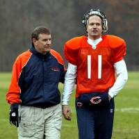 Photo - Chicago Bears Offensive Coordinator Terry Shea, left, walks with new quarterback Jeff George during practice at Halas Hall on Monday, Nov. 29, 2004, in Lake Forest, Ill. George signed a one-year deal with the Chicago Bears on Monday, returning to the NFL after a three-year absence. (AP Photo/Nam Y. Huh) ORG XMIT: ILNH108