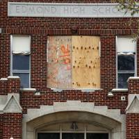 Photo - Renovation work continues on the  entrance of Boulevard Academy. The building was the home of Edmond High School until 1994.