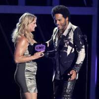 "Photo -  Lenny Kravitz, right, presents the award for female video of the year to Miranda Lambert for ""Mama's Broken Heart"" at the 2013 CMT Music Awards at Bridgestone Arena on Wednesday, June 5, 2013, in Nashville, Tenn.  (AP)"