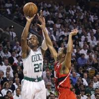 Photo -   Boston Celtics guard Ray Allen (20) shoots over Atlanta Hawks guard Jannero Pargo (7) during the first quarter of Game 3 of an NBA first-round playoff basketball series, Friday, May 4, 2012, in Boston. Allen has been sidelined with bone spurs in his right ankle since April 10. (AP Photo/Charles Krupa)