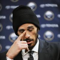 Photo - Former Buffalo Sabres goaltender Ryan Miller collects his thoughts during a news conference as he talked about his years with the NHL hockey team, Friday, Feb. 28, 2014, in Buffalo, N.Y. Miller and Steve Ott were traded to the St. Louis Blues Friday night for goalie Jaroslav Halak, forward Chris Stewart, prospect William Carrier, a 2015 first-round pick and a 2016 third-round pick. (AP Photo/Gary Wiepert)