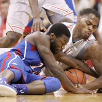 Photo - Ohio State's DeShaun Thomas (1),right, fights for loose ball with Kansas' Elijah Johnson, left, during the first half of an NCAA college basketball game Saturday, Dec. 22, 2012, in Columbus, Ohio. (AP Photo/Mike Munden)