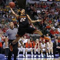 Photo - Oklahoma State's Brittney Martin (22) tries to save the ball during the Big 12 tournament women's college basketball game between Oklahoma State University and Texas Tech University at American Airlines Arena in Dallas, Saturday, March 9, 2012. Photo by Bryan Terry, The Oklahoman